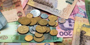 НБУ пояснює падіння гривні загостренням ситуації в Криму і АТО