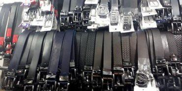 Поліція виявила підпільні цехи, де шили ремені з логотипами відомих брендів